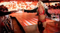 WWE Superstar Mandy Rose hands out her issue of 'Hers' on 'SmackDown.'