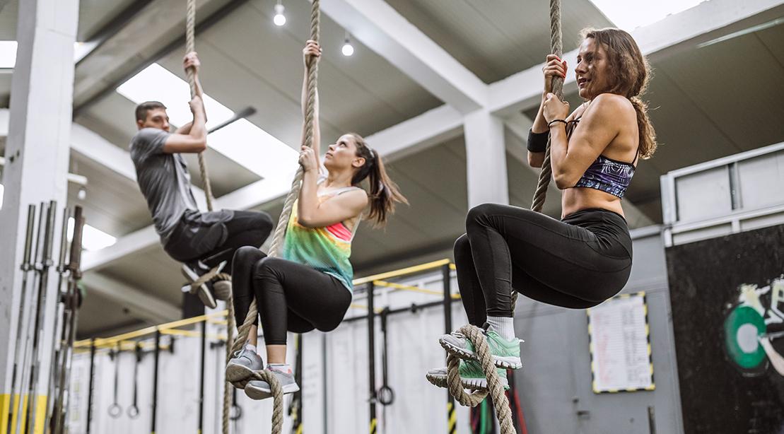 Women Climbing Rope