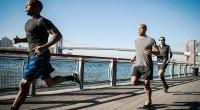 Group of Men Running On Bridge