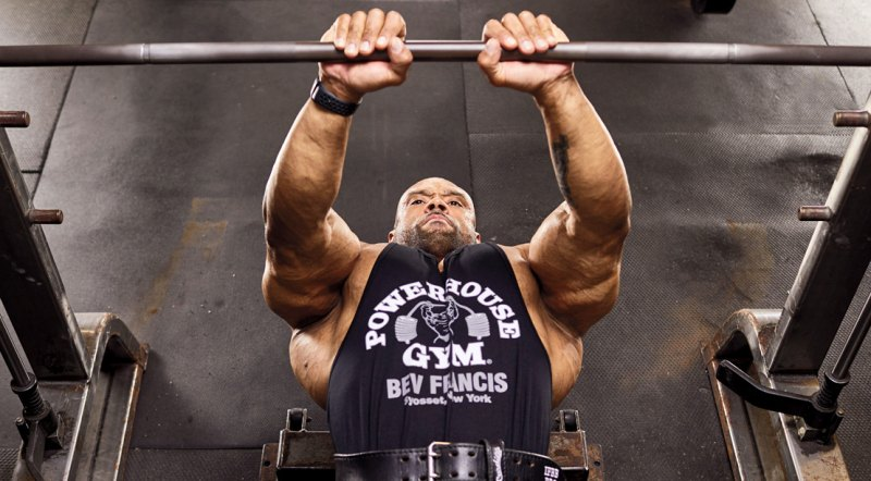 Bodybuilder Juan Morales working out his chest with a close grip barbell bench press exercise