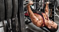 Bodybuilder doing a chest workout with the chest exercise the decline bench press exercise