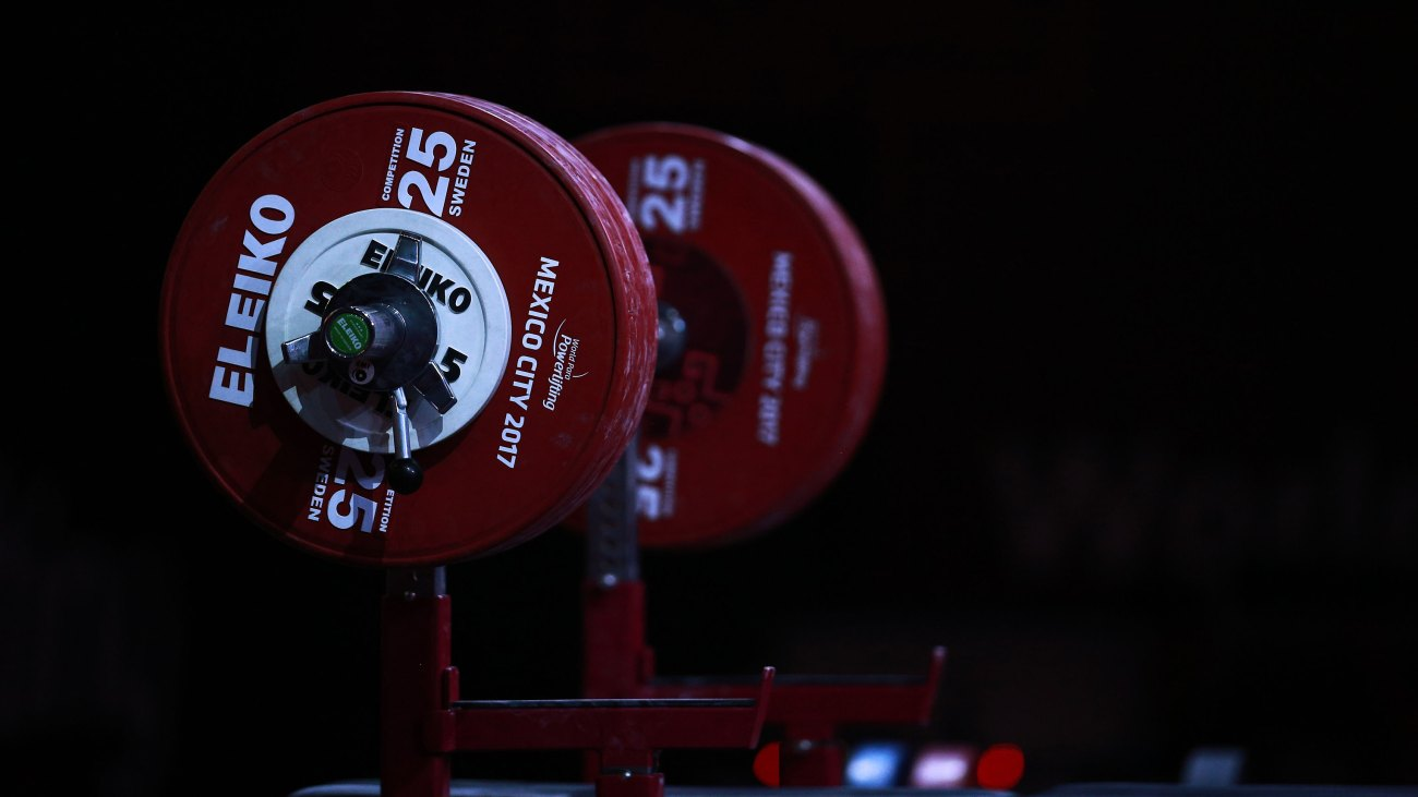 A barbell loaded with weight