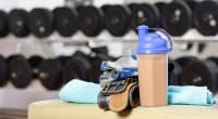 A protein shake on a gym bench.