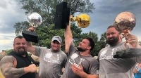 Martins Licis hoists up his 2019 World's Strongest Man trophy in Bradenton, Florida.