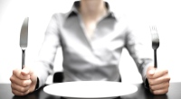 Woman-Holding-Knife-Fork-Empty Plate