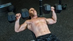 Man Exercising - Dumbbell Bench Press