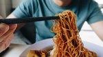 Man Eating Noodles