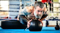 older man gym pushup medicine ball 1109