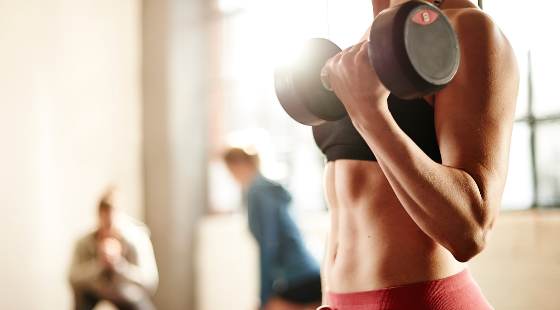 Woman Lifting Weights With Dumbbells