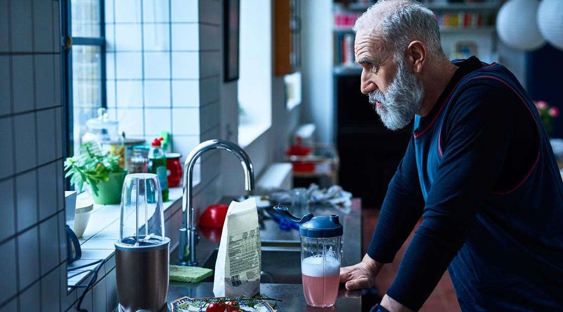 Aging-Man-Protein-Shake-Staring