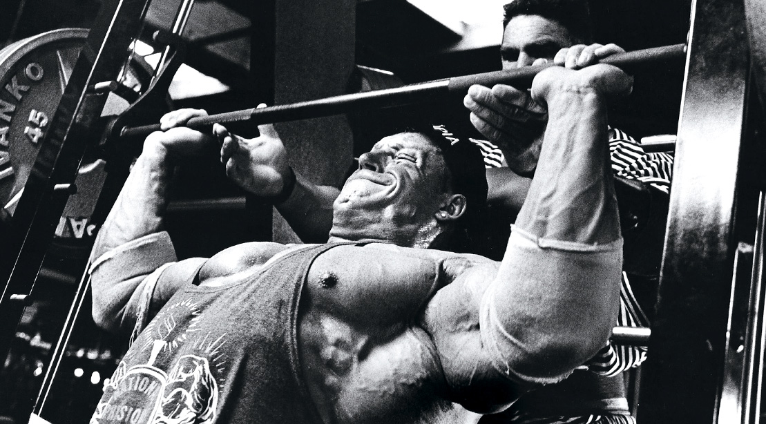 Bodybuilder Dorian Yates doing a chest workout performing a Incline Chest Press Exercise