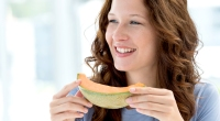 Female-Eating-Cantaloupe