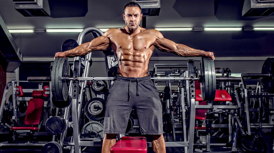 Male-Bodybuilder-Standing-Bench-Barbell