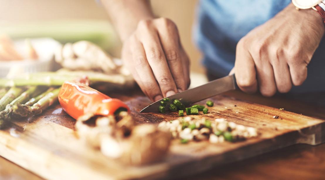 Male-Prepping-Food-Cutting-Board