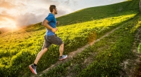 Man-Running-Up-Grassy-Hill