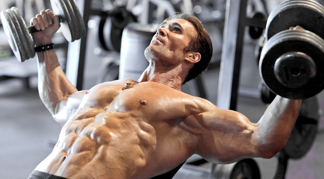 Bodybuilder Michael O' Hearn performing a incline dumbbell flye exercise