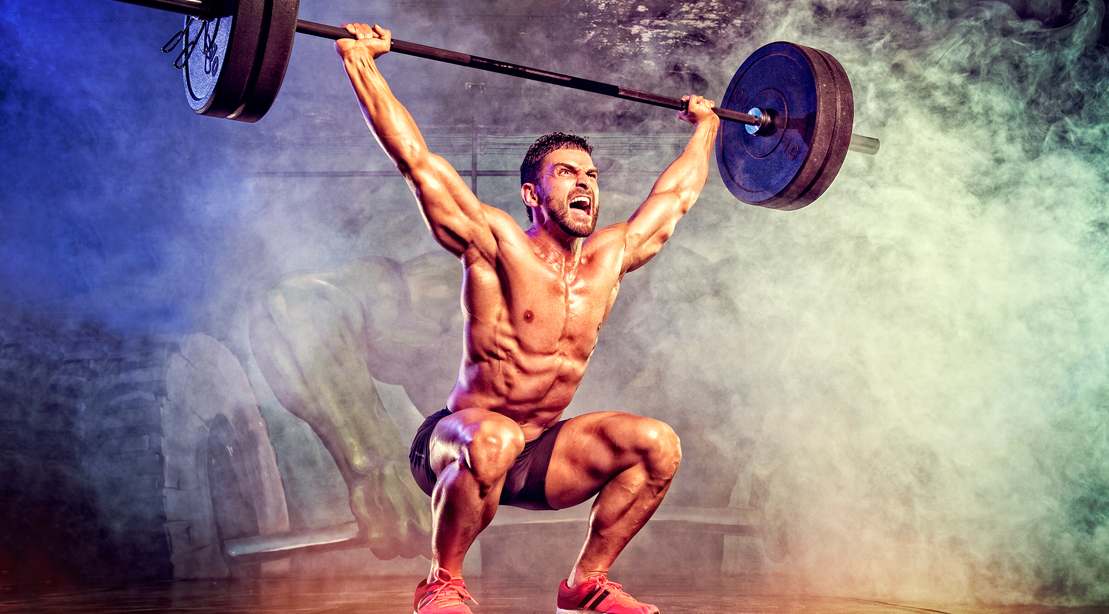 Fit crossfitter performing an olympic squat for power and explosiveness