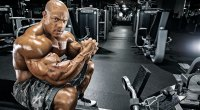 Phil Heath sitting on a bench in deep thought
