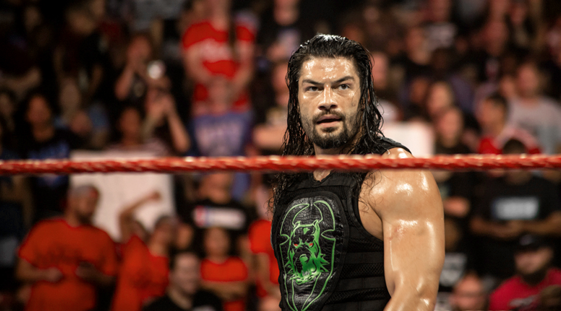 Roman Reigns standing in the ring at a WWE Reunion