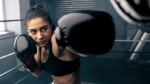 Female Boxer throwing left jab in a boxing ring