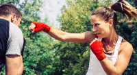 Female boxer boxing outdoors throwing a jab