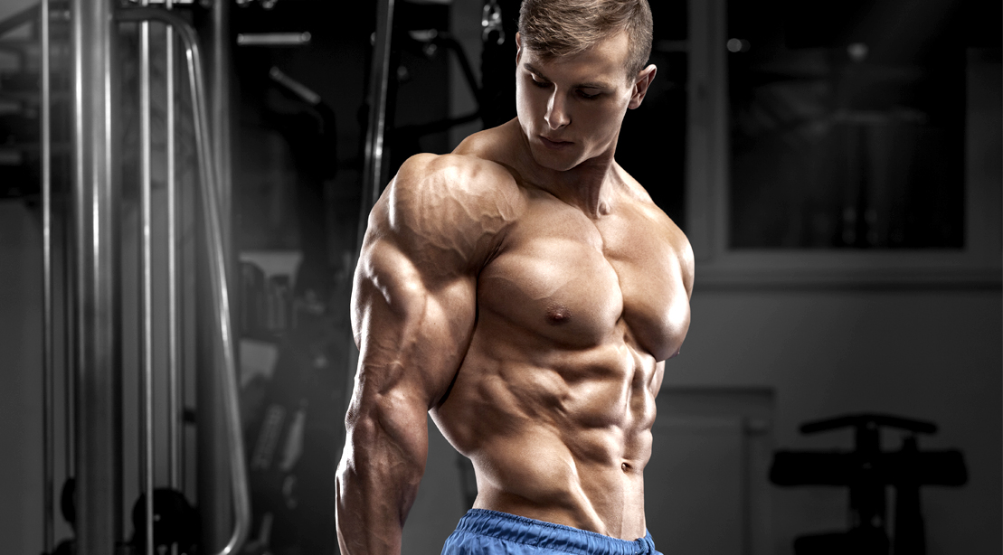 Male fitness model showing his triceps muscles