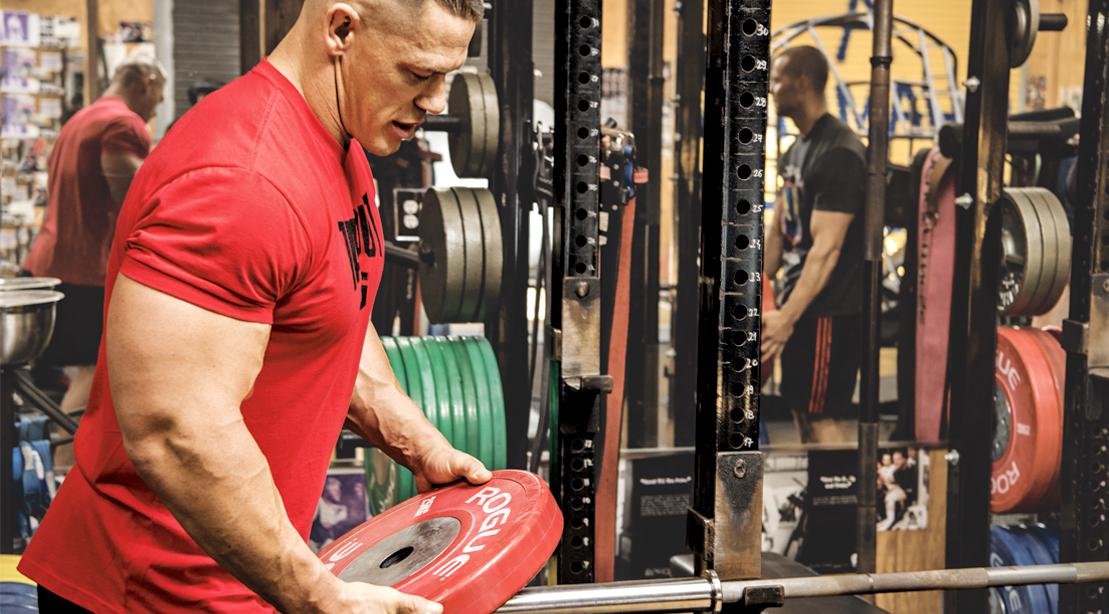 John-Cena-Placing-Weights-On-Bar