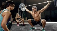 Ladies-Looking-At-Guy-Barbell-Snatch