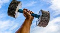 Lifting-Heavy-Stone-Dumbbell-Sky