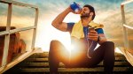 Man drinking water to stay hydrated after following our hydration tips to avoid dehydration