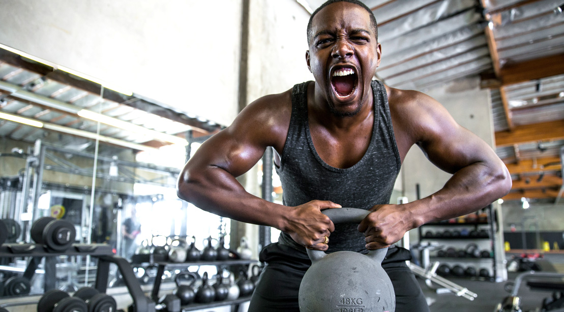 Man-LIfting-Kettlebell-Screaming and breaking his fitness plateau