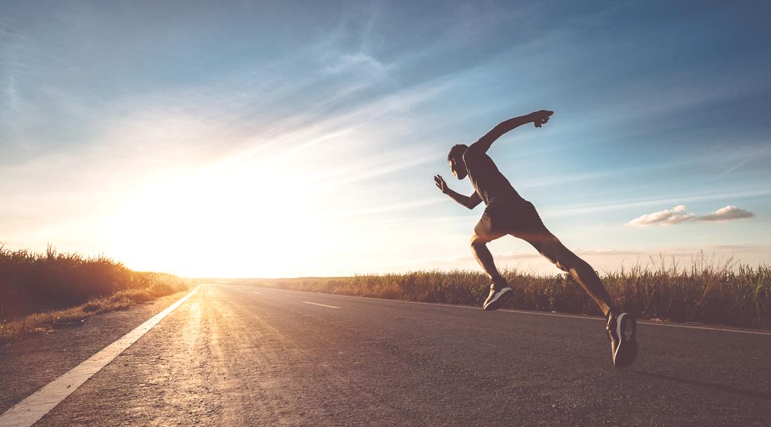 Man-Sprinting-Into-Sunset-Empty-Road