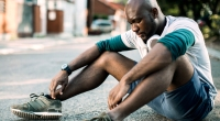 Man-Tired-Sitting-On-Streets