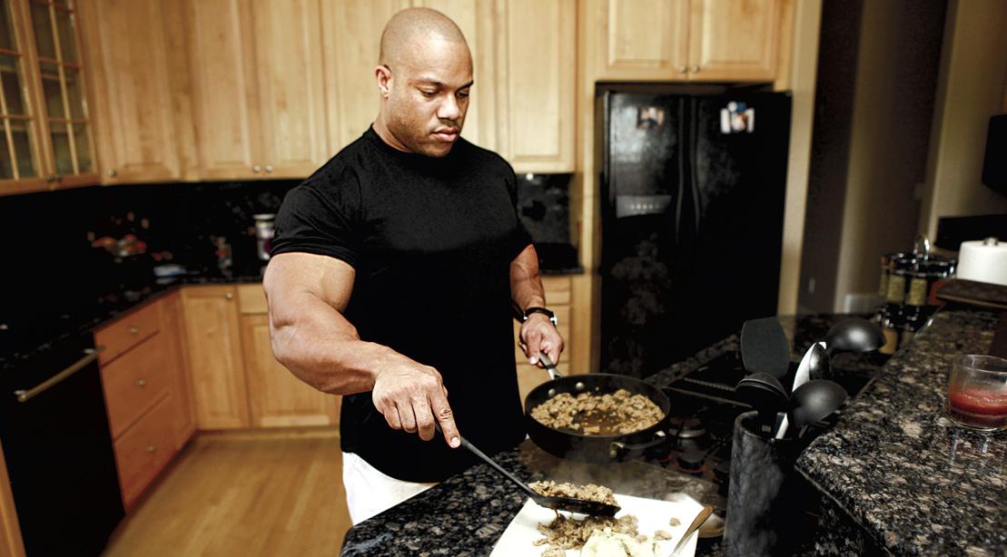 Bodybuilder Phil Heath cooking dinner in his home kitchen