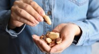 Woman holding a handful of various nuts