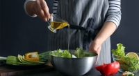 Cook-Adding-Oil-To-Salad