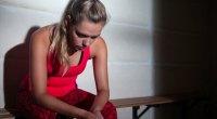 Depressed-Fitness-Girl-Sitting-On-Bench-Shadows