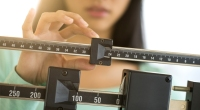 Girl-On-Scale-Adjusting-Weight