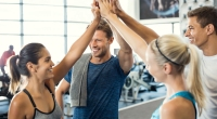 Group-High-Five-Postive-People-In-Gym