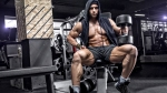 Guy-in-Hoodie-Posing-Barbell-Bench-Dumbbells
