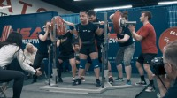 a competition back squat done in knee sleeves