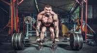 Man deadlifting 495 pounds