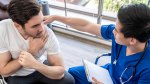 Physical-Examination-Young-Man-Consulting-Doctor-Shoulder-Pain