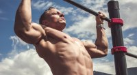 Shirtless-man-pullup-blue-sky