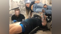 Thor Bjornsson Bench Pressing His Wife While Getting Tattooed