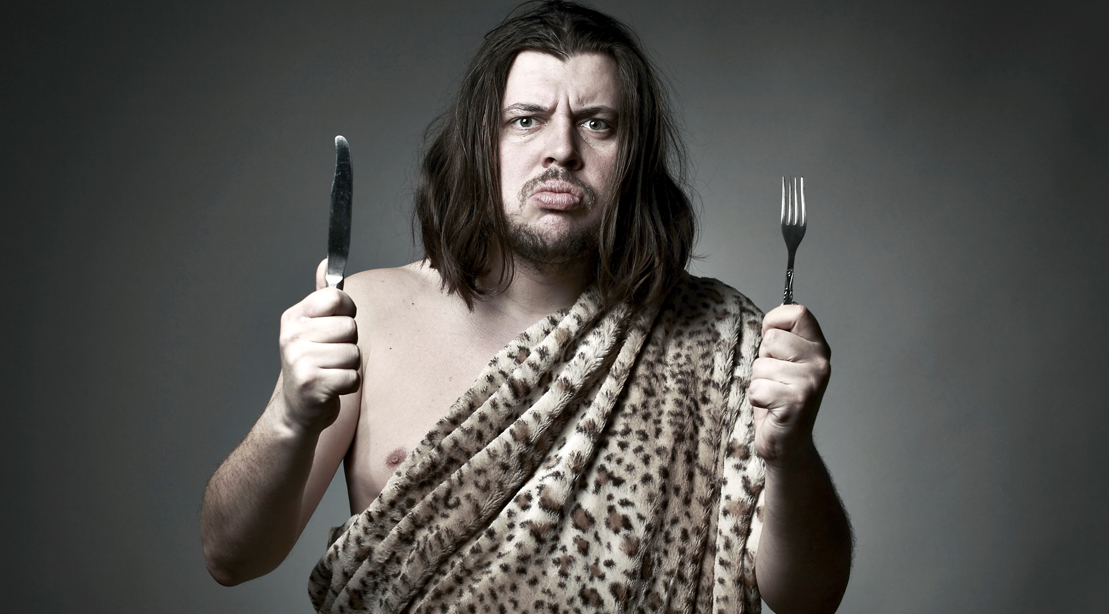 Caveman-Holding-Fork-and-Knife-Paleo-Diet