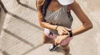Girl-Checking-Fitness-Tracker-Watch