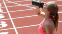 Girl-Drinking-Protein-Shake-On-Track