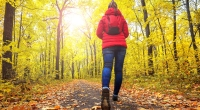 Girl-In-Puffy-Jacket-Walking-Through-Park-Fall-Time