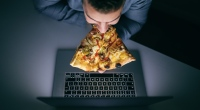 Guy-Eating-Pizza-In-Front-Of-Laptop-Light